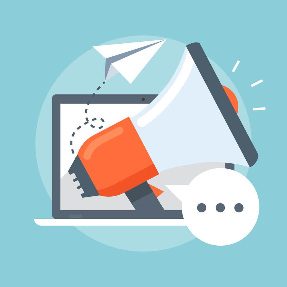 Imagem em vetor de um megafone na frente de um notebook, indicando a importância dos links patrocinados